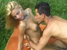 Perky blond shemale fucks in nature