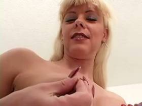 Blond tgirl rubbing her cock and jizzing on mirror