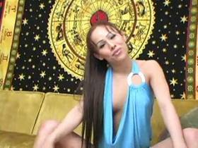 Hot longhair shemale masturbating on yellow sofa