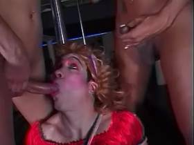 Crossdressed chap humiliated by couple of shemales