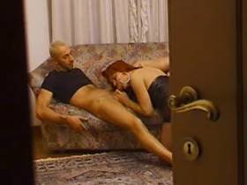 Redhead shemale in leather boots fucking on carpet