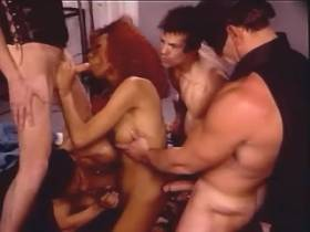 Cockloving redhead shemale blowing in drunken orgy